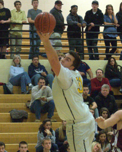 Len helps Souhegan boys basketball beat Goffstown for first win