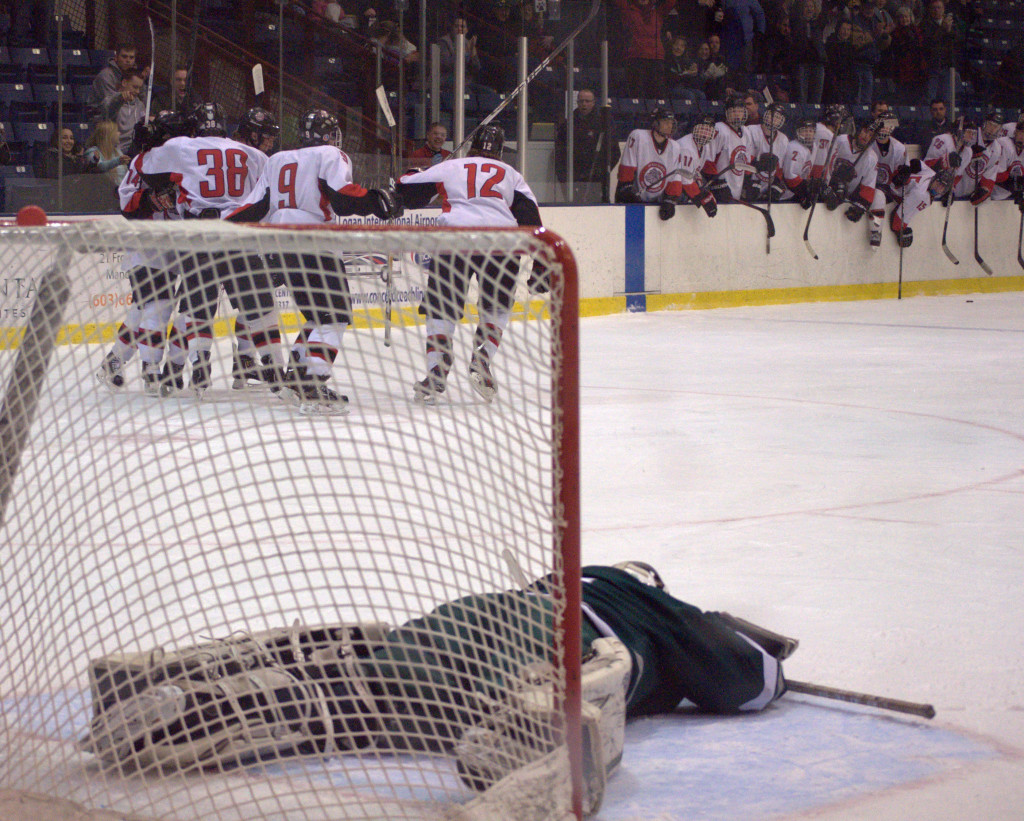 Kingswood goalie Shawn Goggin lays on the ice after Bedford's Chris O'Hara (No. 38) scored late in the second period Saturday.
