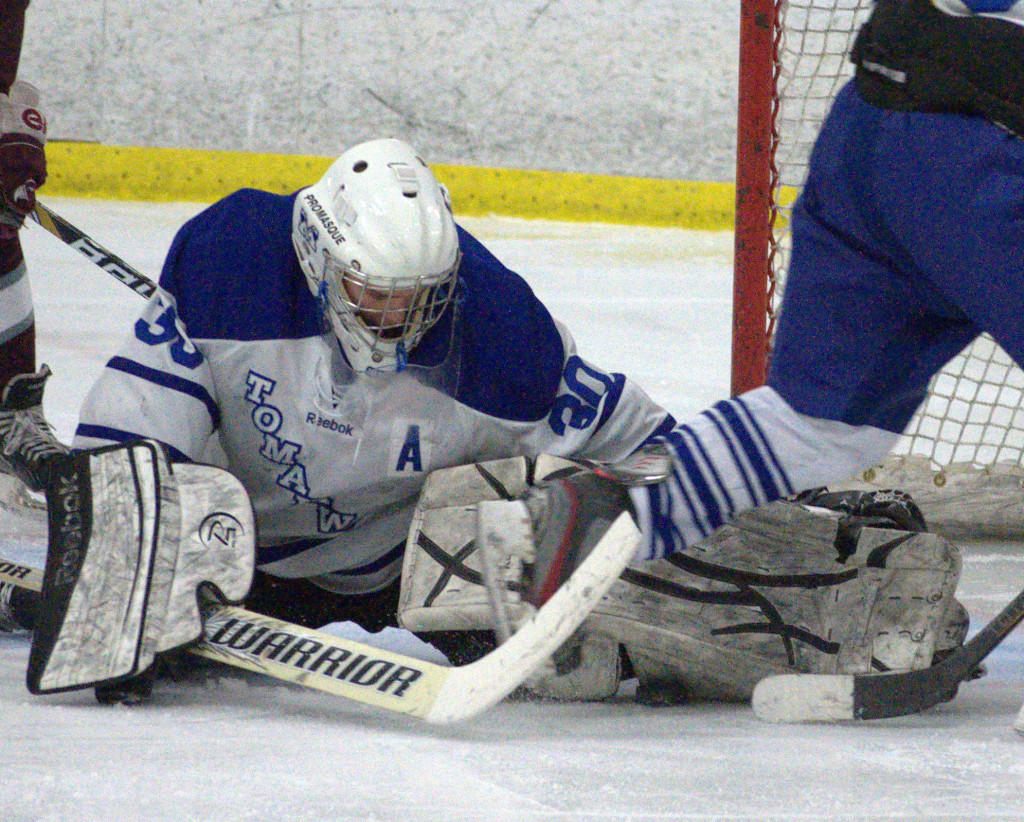 Merrimack's Brett Glendye makes a save during Saturday's game against Goffstown. For more photos, go to the Photo Album.