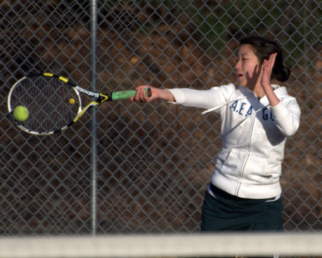 Bishop Guertin's Jennifer Dai returns a shot during a match Monday against Bedford. For more photos, go to the Photo Album.