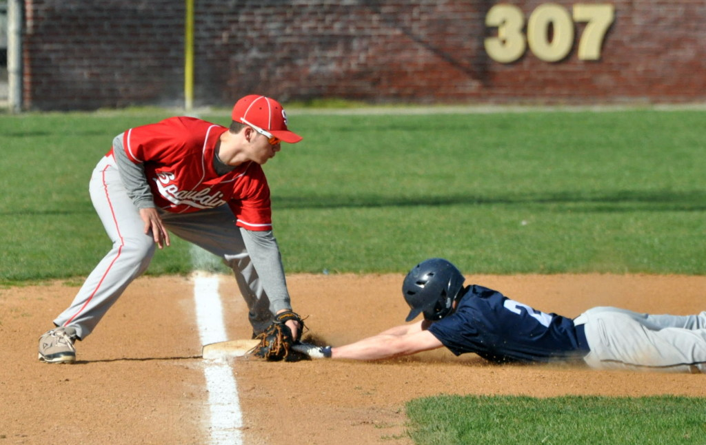 Spaulding's Loukas Brigham tags Nashua North's Spencer Madden at third during Wednesday's game. For more photos, go to the Photo Album.