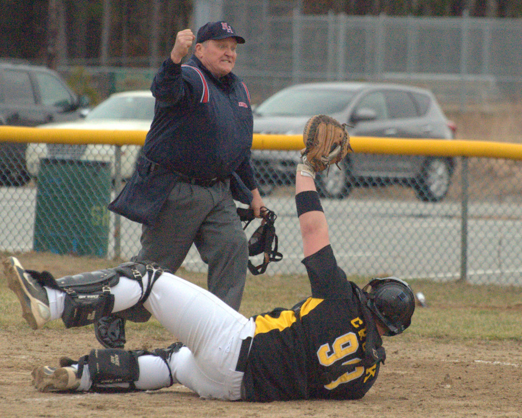 Souhegan catcher Cam Crook holds up the ball after tagging Lebanon's Grayson Hardy during last Wednesday's game.