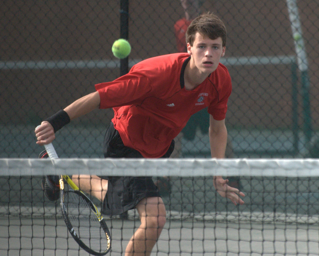 Bedford's McKinley Grimes watches as his shot goes over the net during Tuesday's championship match against Exeter.