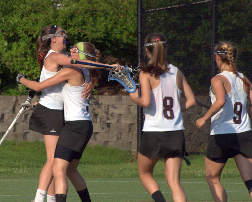 Members of the Hanover girls lacrosse team celebrate after scoring a goal during Saturday's semifinal against Bishop Guertin.