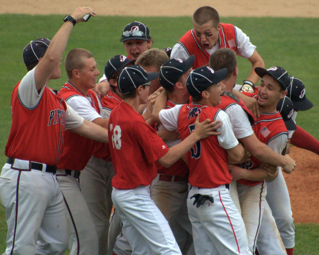 Members of the Pittsfield baseball team celebrate after beating Littleton in the Division IV title game.