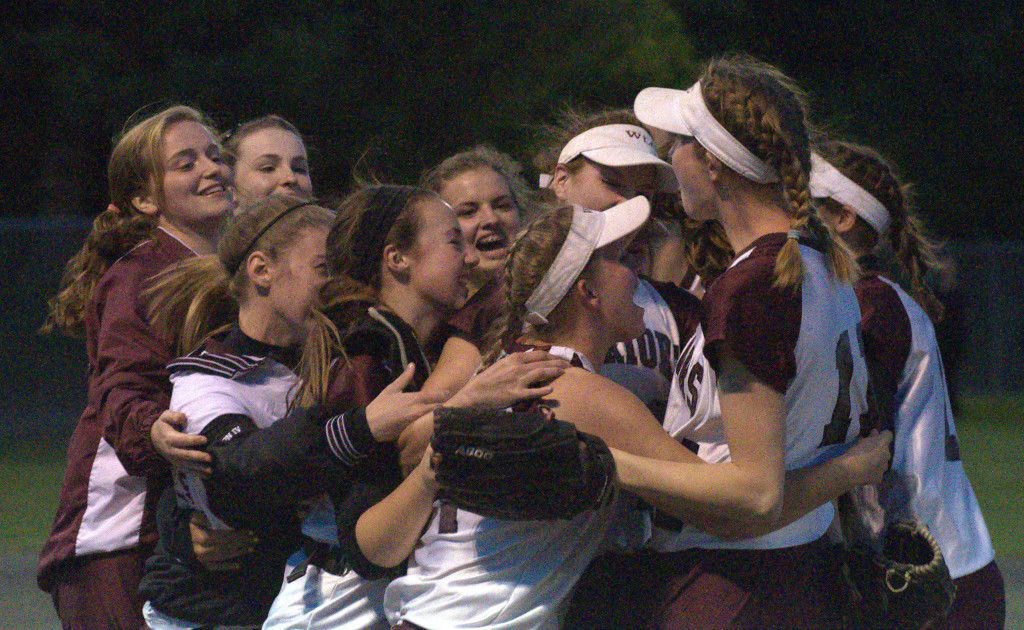 The Wilton-Lyndeborough softball team celebrate beating Profile in the Division IV semifinals.