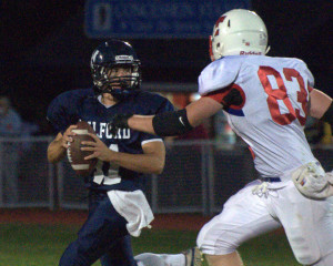Trinity football scores twice in fourth quarter to beat Milford