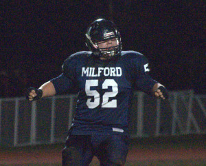 Milford football rolls past Souhegan