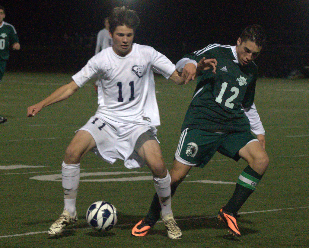 Hollis Brookline's Nate Rogers and Pembroke's Brendan Pettigrew battle for the ball during Thursday's semifinal.
