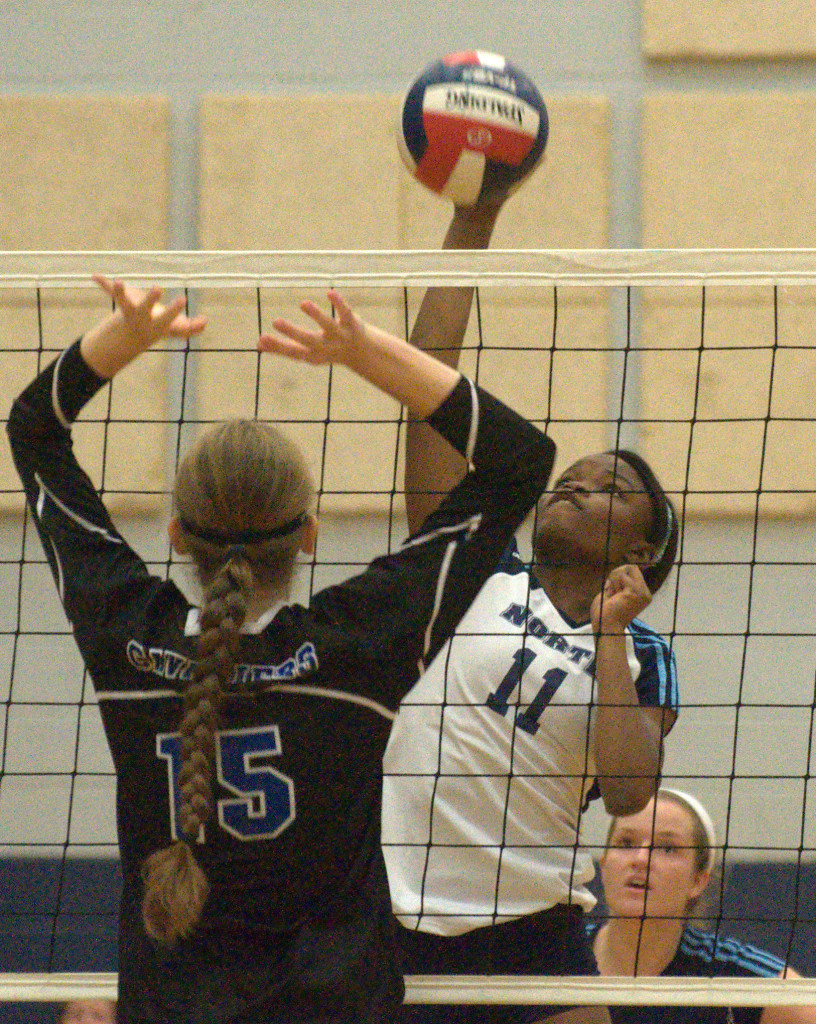 Nashua North's Adaeze Okorie hits the ball during Thursday's match against Hollis Brookline.