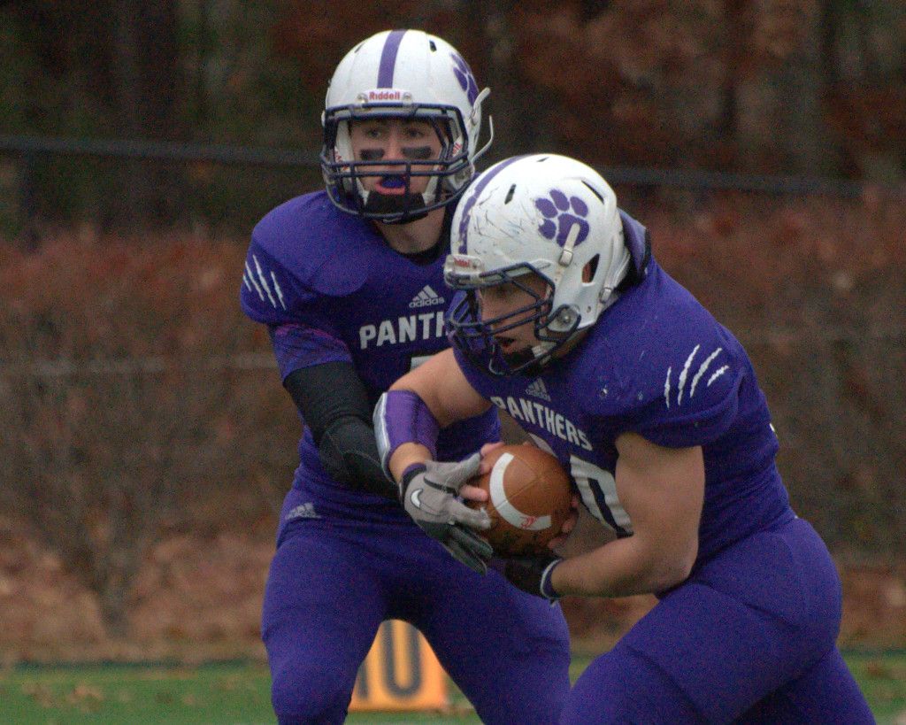 Nashua South's Andrew DeCarteret takes a handoff from Trevor Knight.