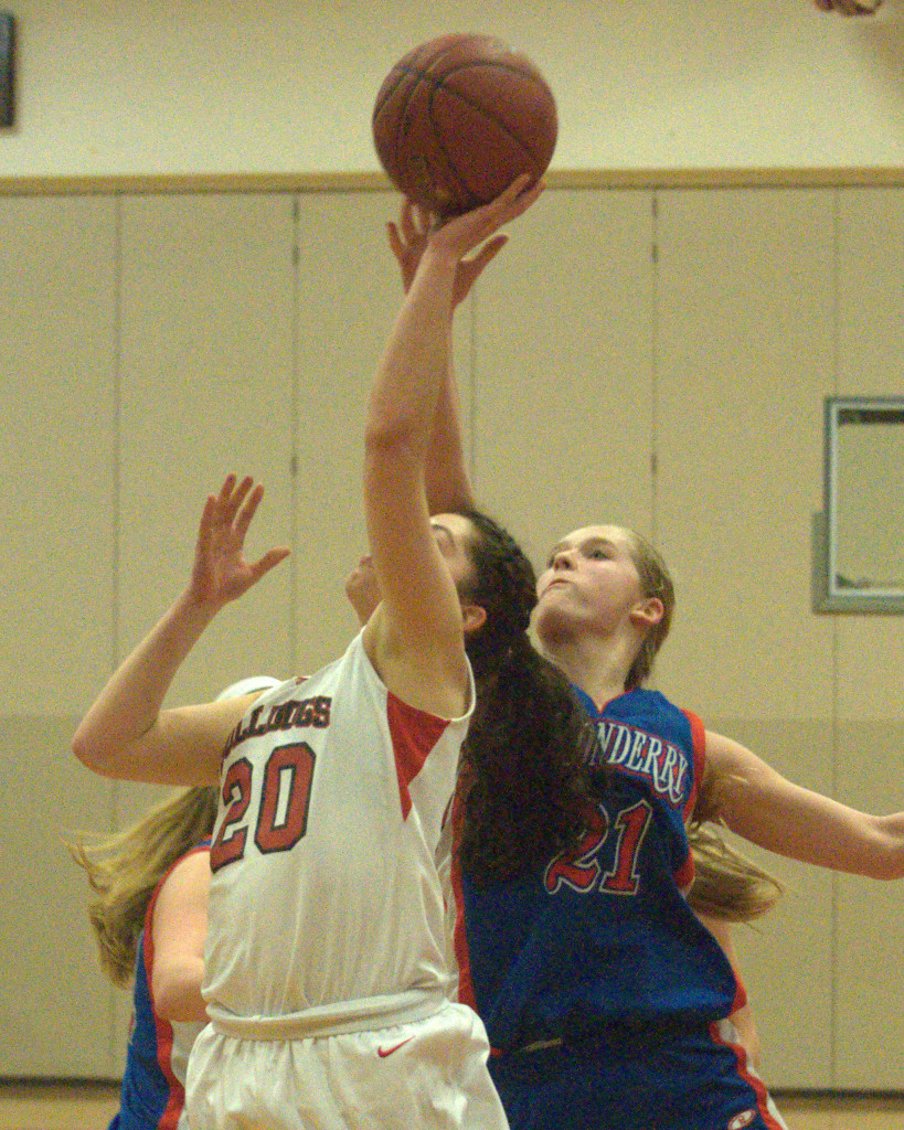 Londonderry's Kelsey Coffey blocks a shot by Bedford's Nikki Tucci during a game last season.