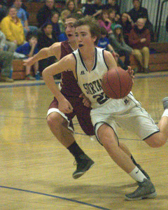 Portsmouth boys basketball overcomes slow start to top Milford