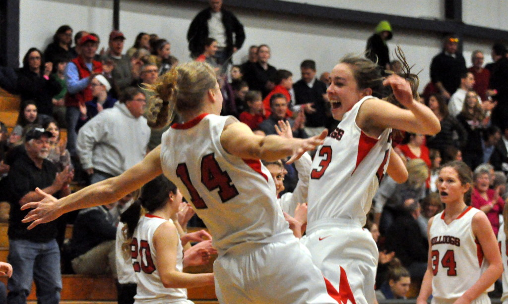 Bedford's Haley Driscoll, left, and Ali Glennon celebrate after Thursday's semifinal win over Londonderry.