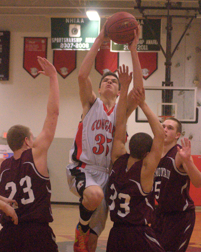 Campbell's Zach Bergeon drives the lane during Thursday's game against Fall Mountain.