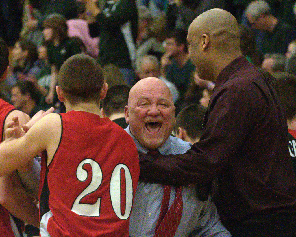 Campbell coach John Langlois celebrates after the Couargs defeated Berlin on Friday.