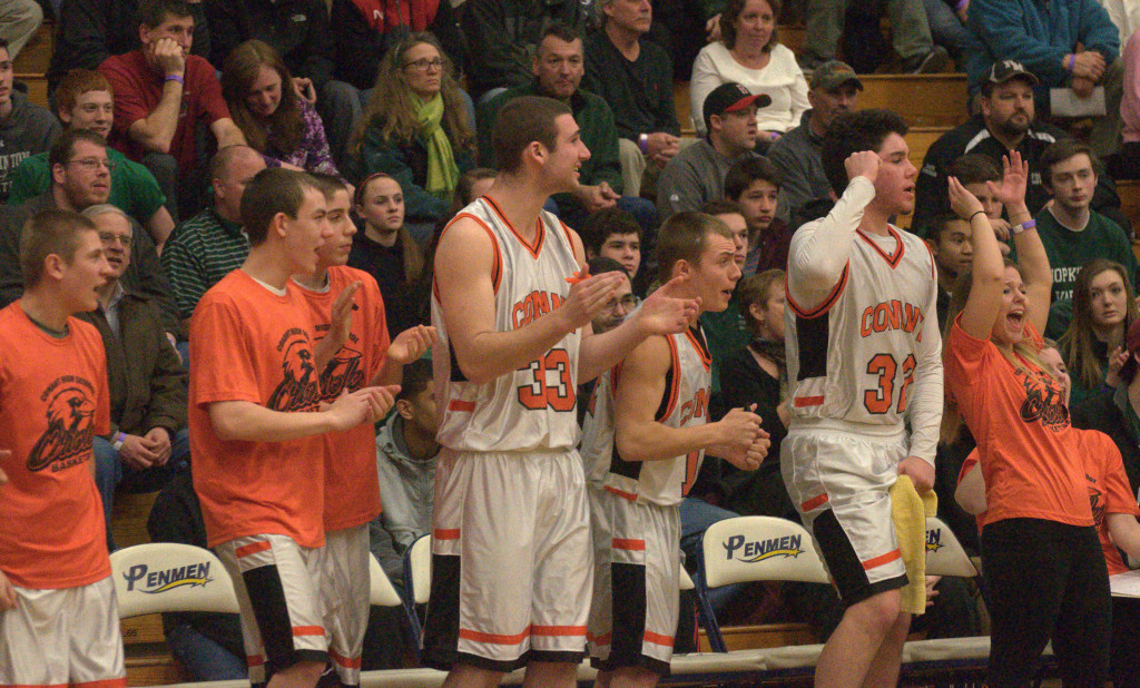 The Conant bench celebrates during the fourth quarter of Friday's game against Berlin.