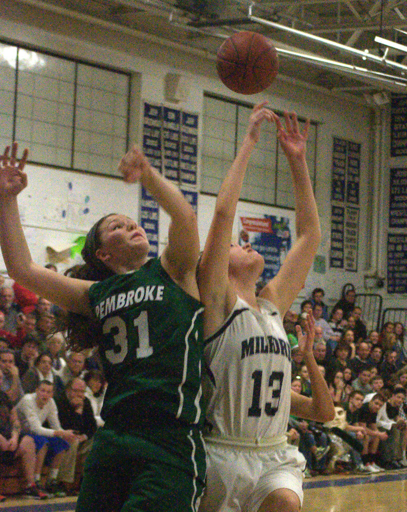 Milford's Rebecca Cleary and Pembroke's Marissa Kibbee battle for a rebound during Friday's game.
