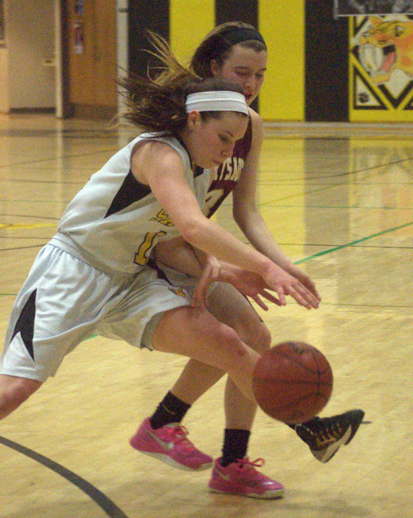 Souhegan's Morgan Brady and Portsmouth's Izzy Pafford chase after a loose ball during Friday's game.