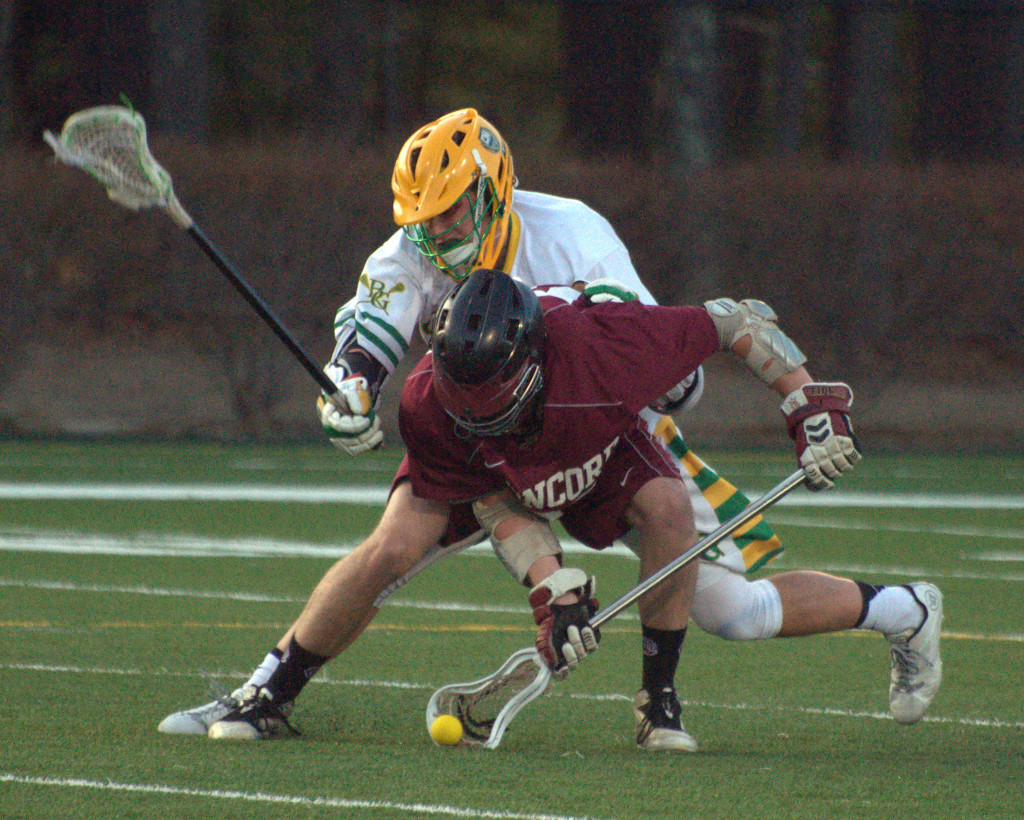 Concord's Tim Weinhold scoops a ground ball in front of Bishop Guertin's Tom Hurley during Monday's game.