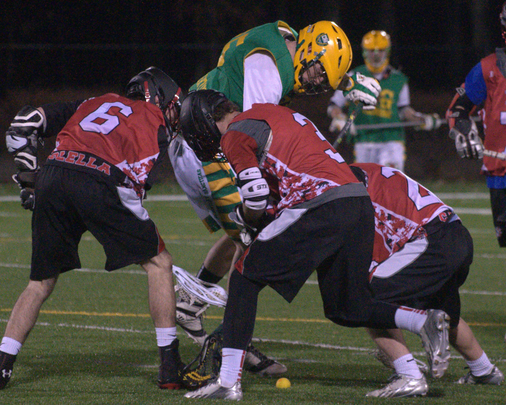 Bedford players battle for a ground ball with a Bishop Guertin player during Wednesday's scrimmage.