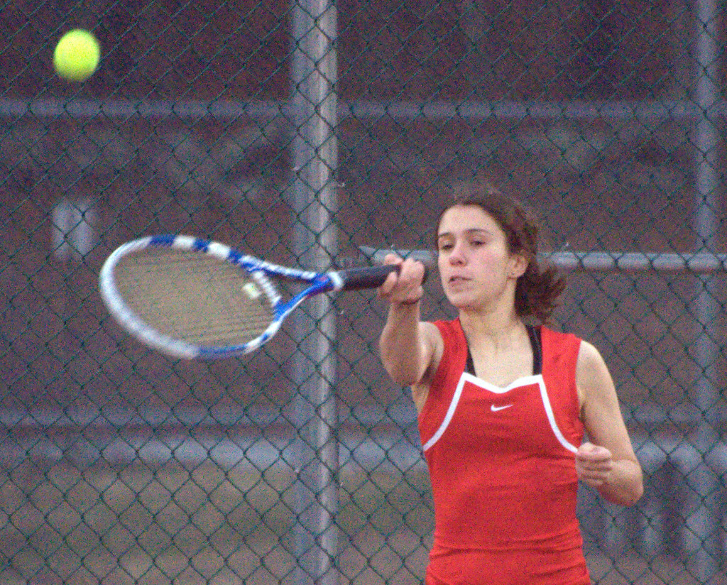 Bedford's Anna Corrao returns a shot during her doubles match against Bishop Guertin on Monday.