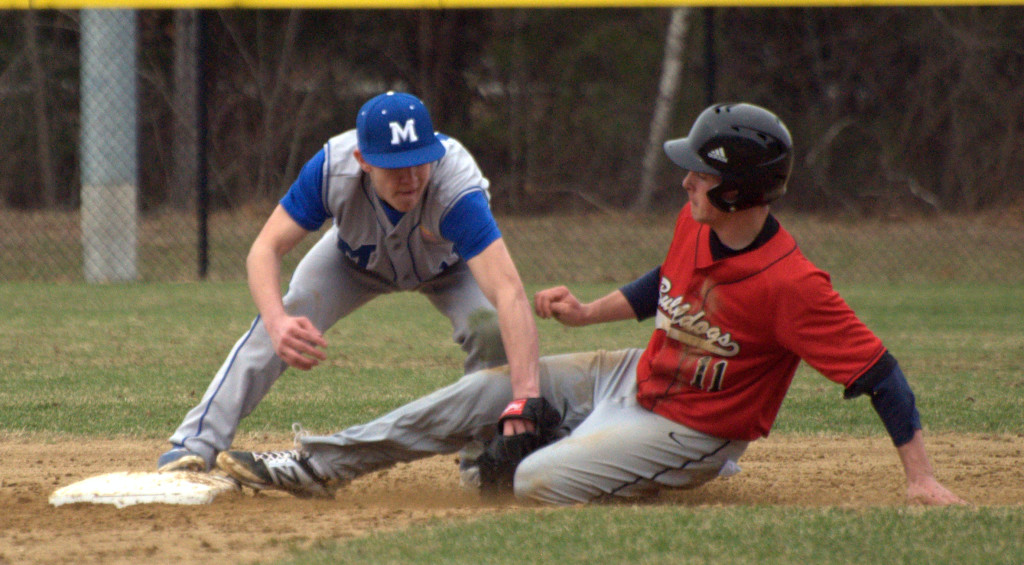 Merrimack's Chad Seaver tags out Bedford's Nick Angelini as he tries to steal second during Friday's game.