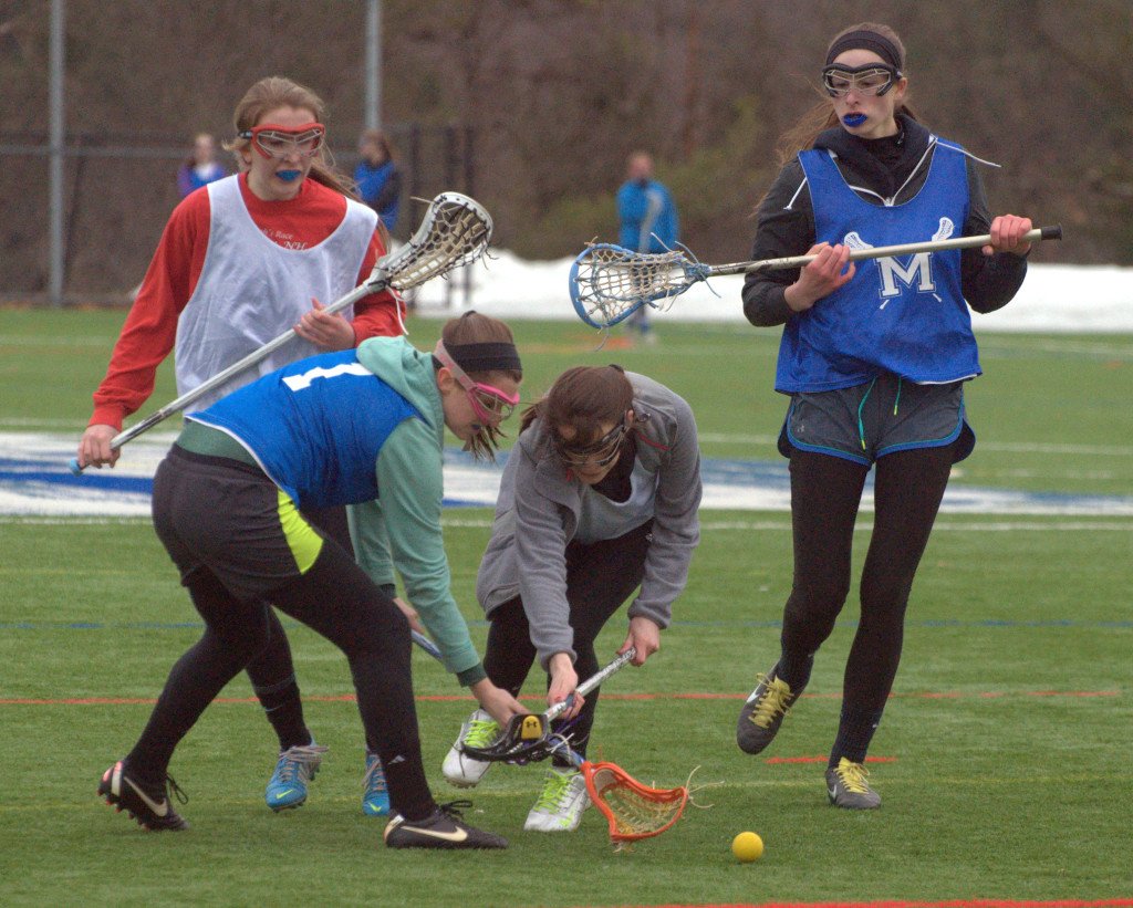 Merrimack players go after a ground ball during practice earlier this week.