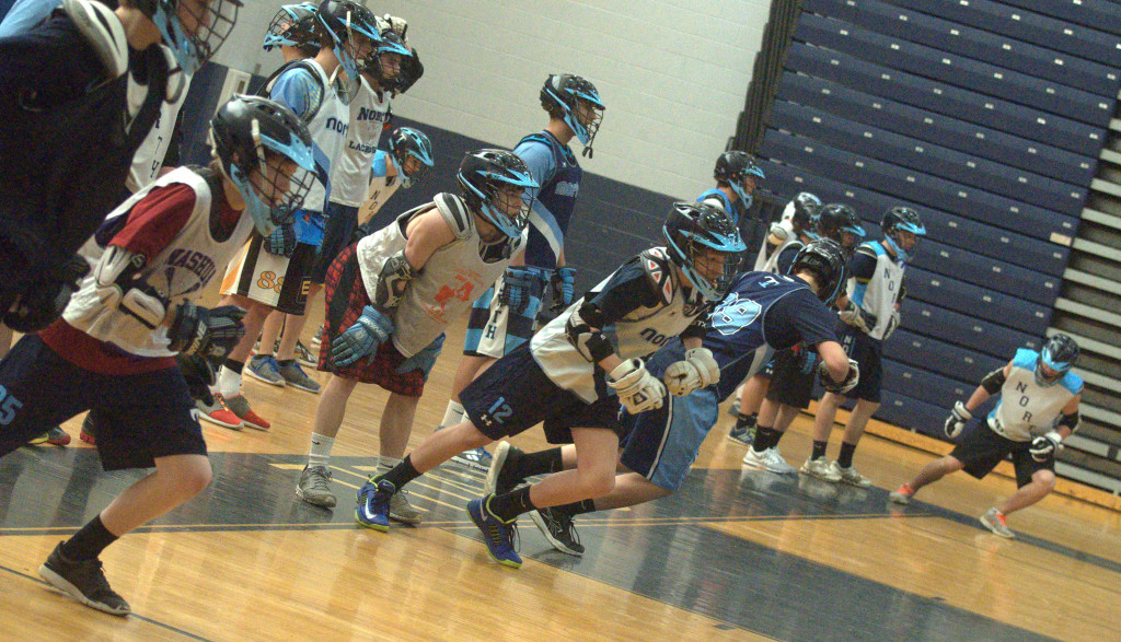 Nashua North players run sprints during practice earlier this week.