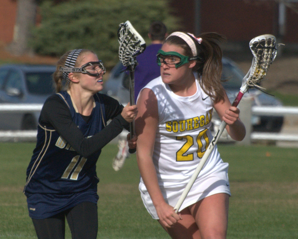 Souhegan's Mickenzie Larivee tries to get by Windham's Alexandra Lewis during Thursday's game.