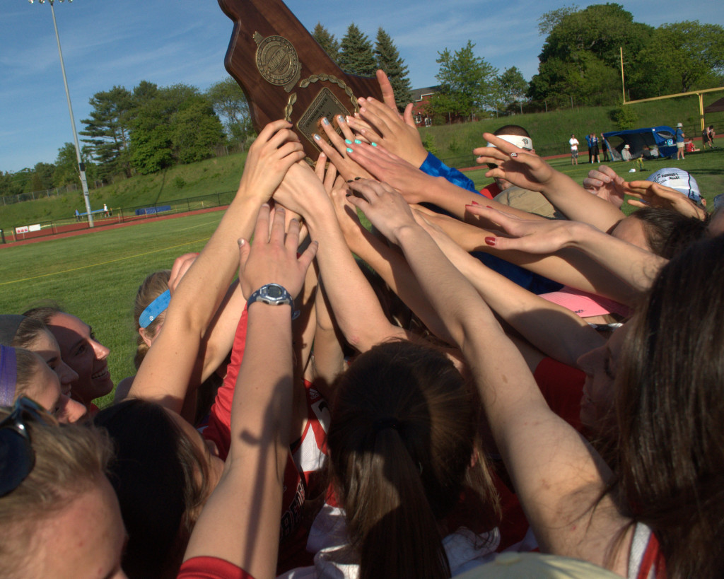 The Bedford girls track team celebrates after winning the Division I title. For more photos, go to the Photo Album.