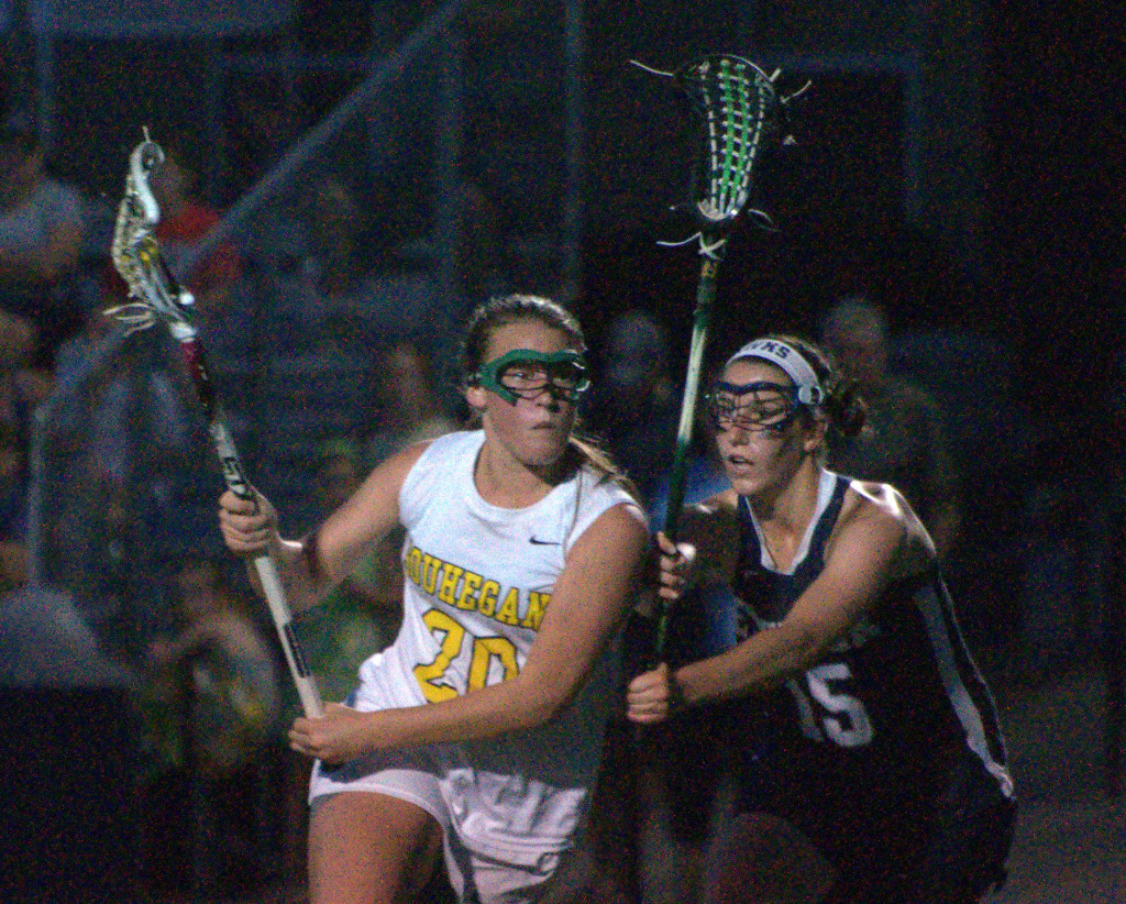 Souhegan's Mickenzie Larivee tries to get by Exeter's Kristina Keith during Saturday's semifinal.