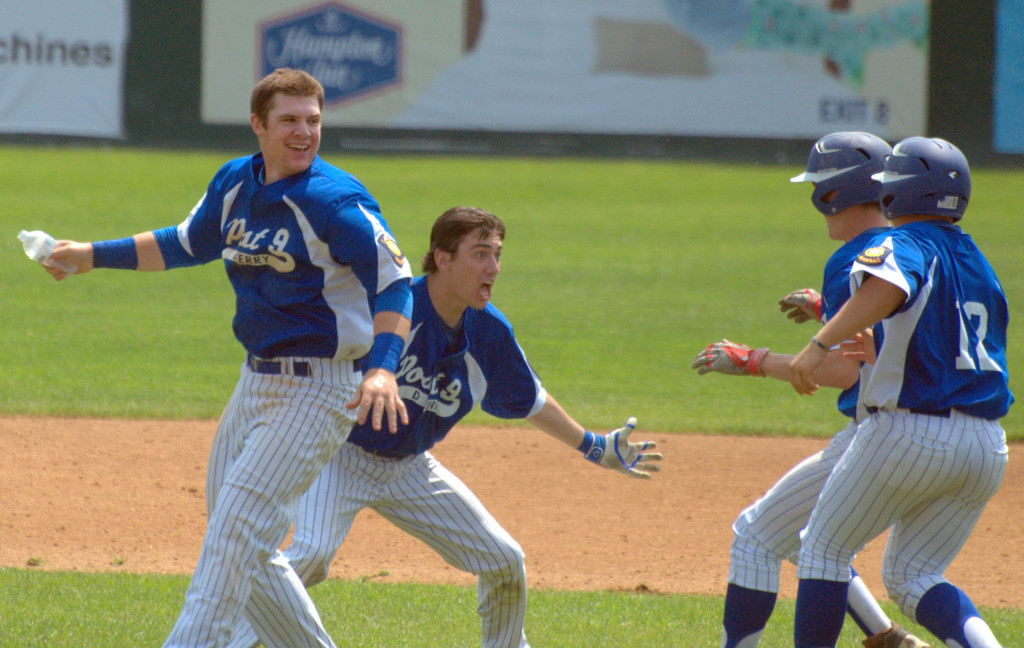 Derry players celebrate after Pat Mahoney (center) hit a walkoff single to beat Concord on Friday.