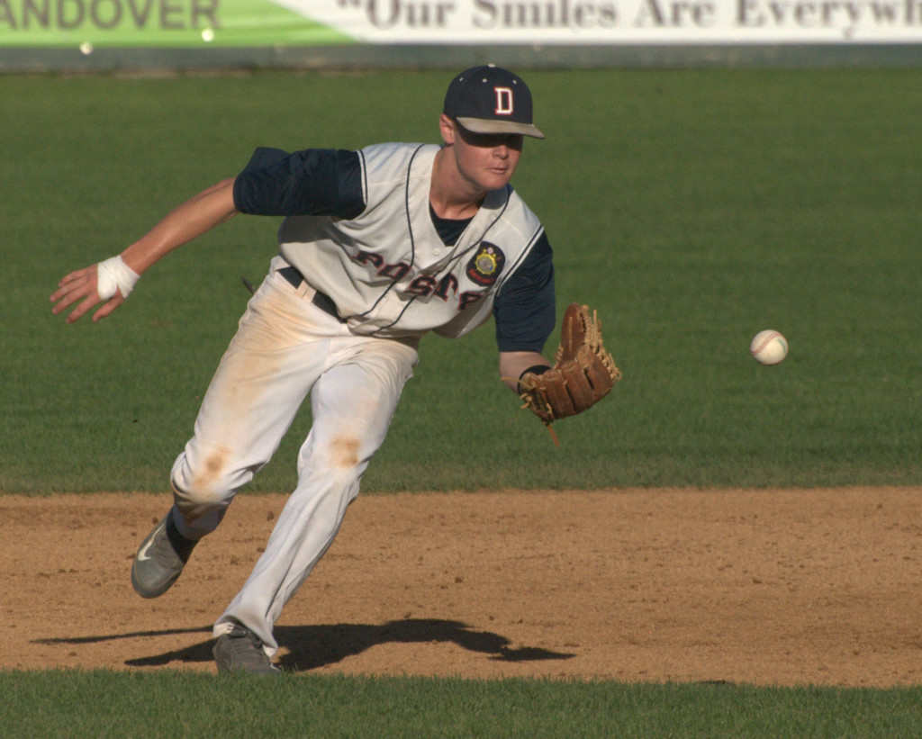 Dover's JT Bishop tracks down a groundball during Thursday's game against Concord.