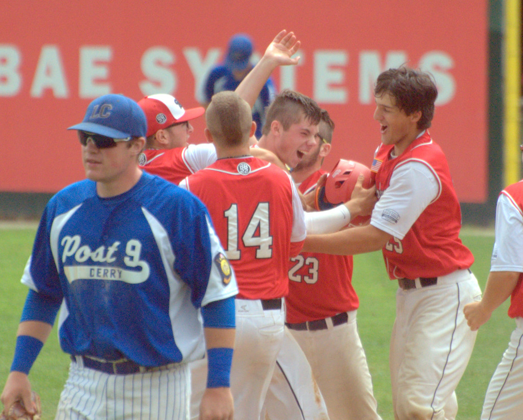 Lebanon players mob teammate Ben Robinson, center, after his walkoff single to beat Derry in Thursday's game.