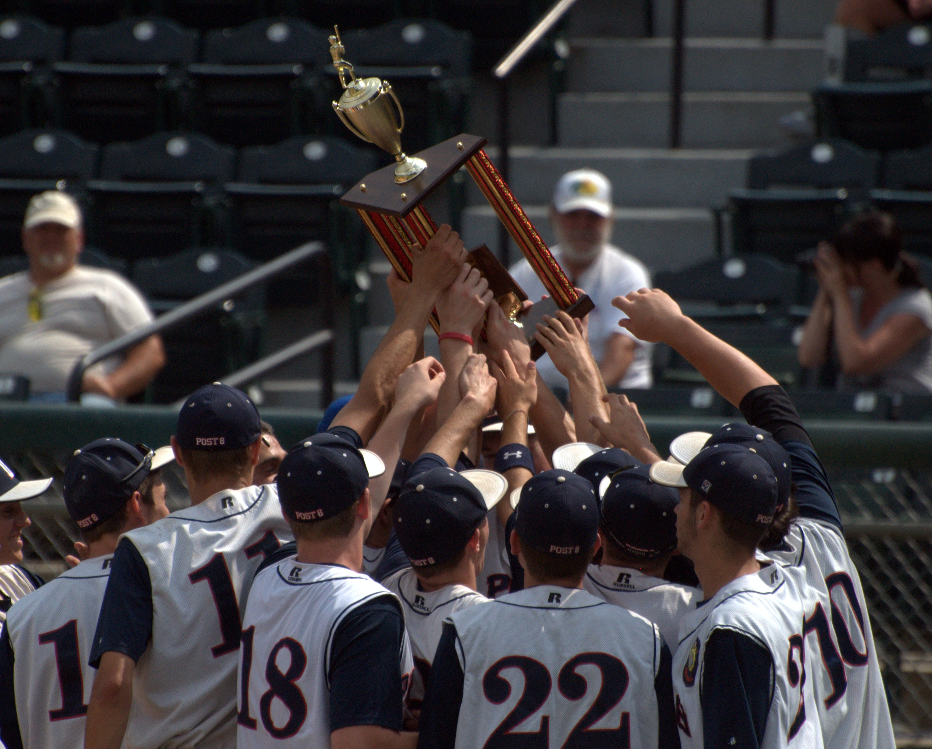 Dover players hold up the American Legion Senior Championship trophy after beating Derry on Tuesday.