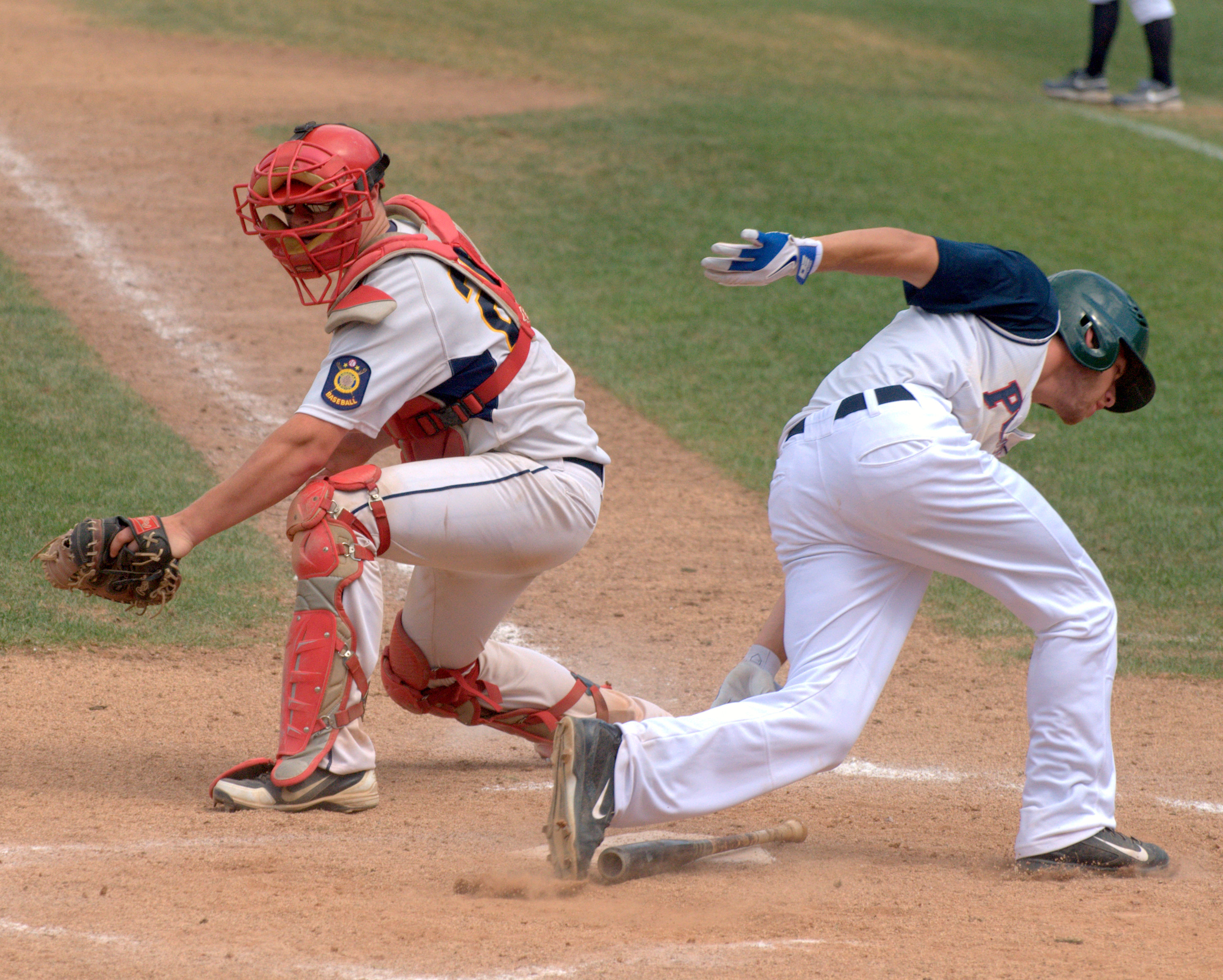 Dover's Mike Wasserman scores a run before Hudson's Greg Emanuelson can make a tag during Saturday's game.