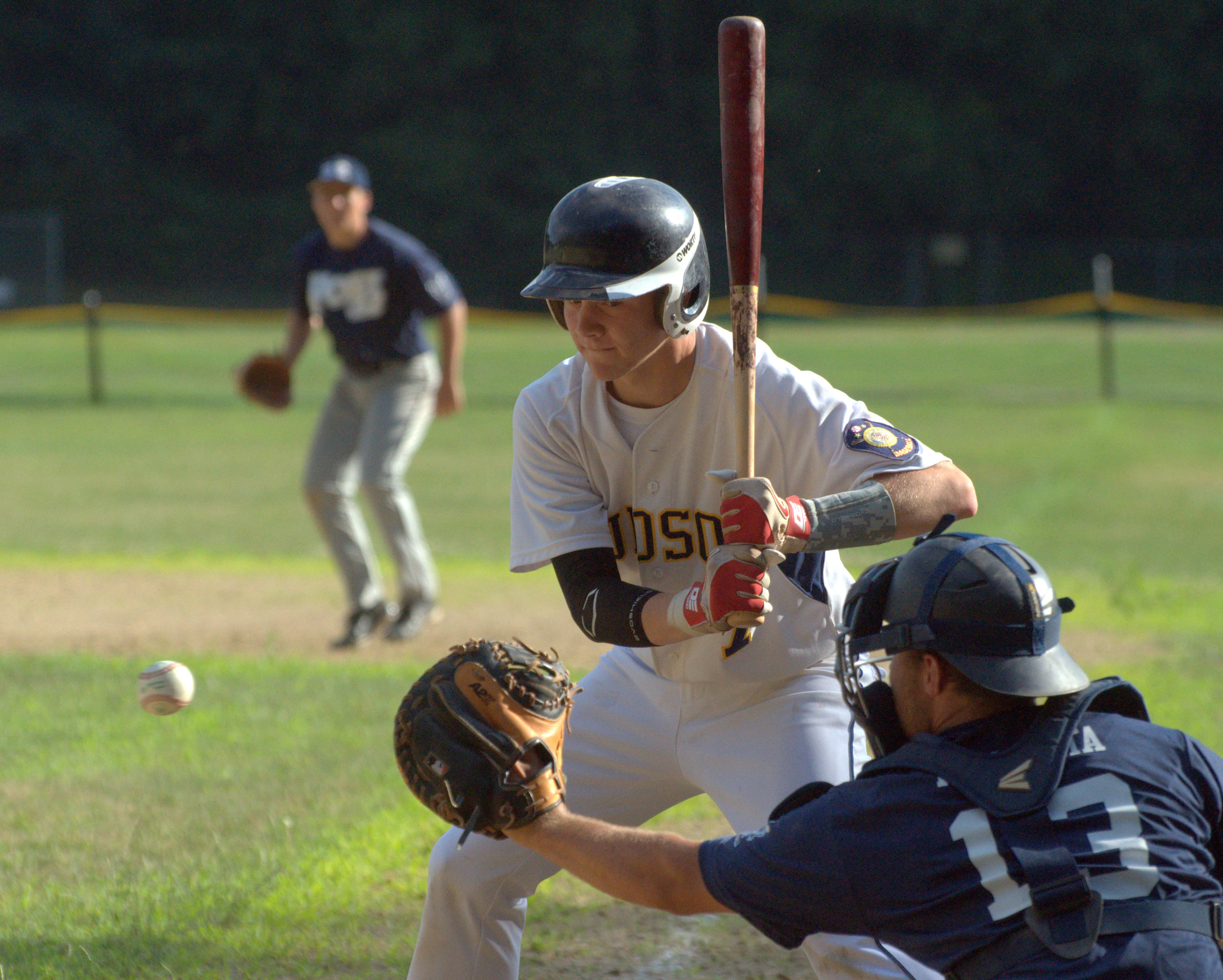 Hudson's Dan Brown takes a pitch during Friday's game against Exeter.