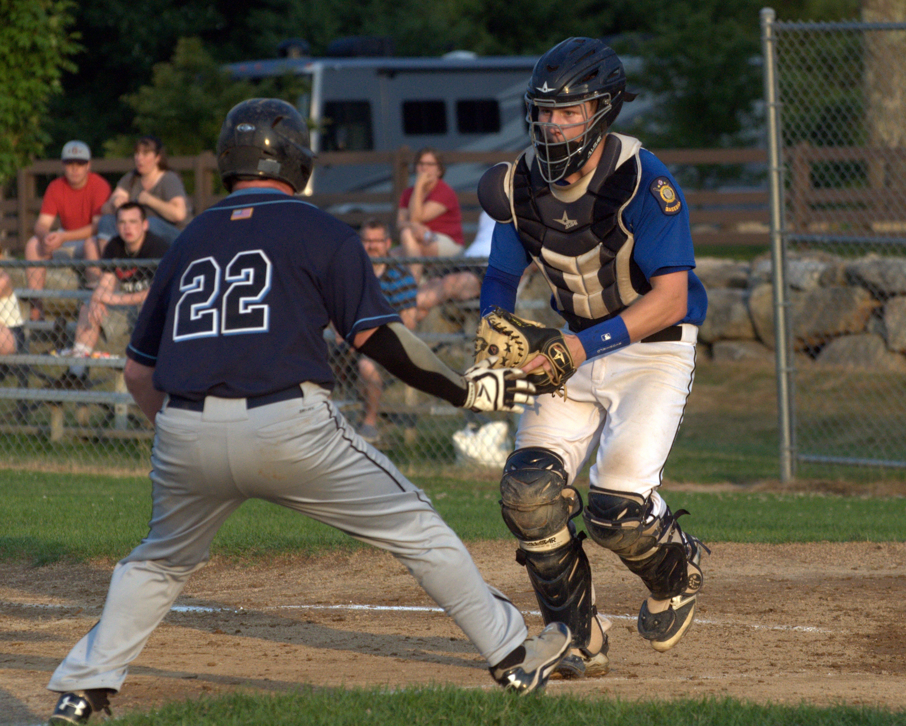 Goffstown's David Nelson waits to tag Bedford's A.J. Schiappa during Tuesday's game.