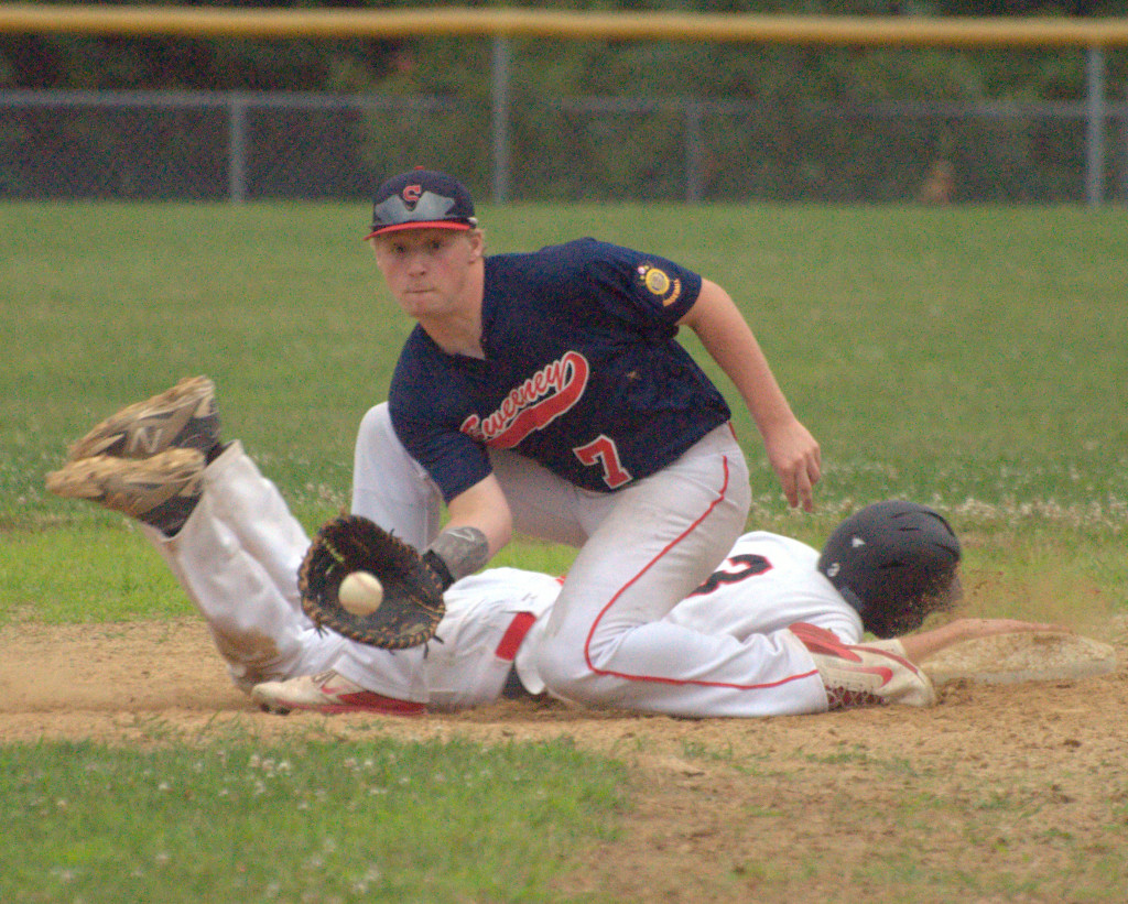 Sweeney's Grant Corbett fields a pickoff attempt as Milford's Tommy Bennett dives back into first on Monday. For more photos, go to the Photo Album.