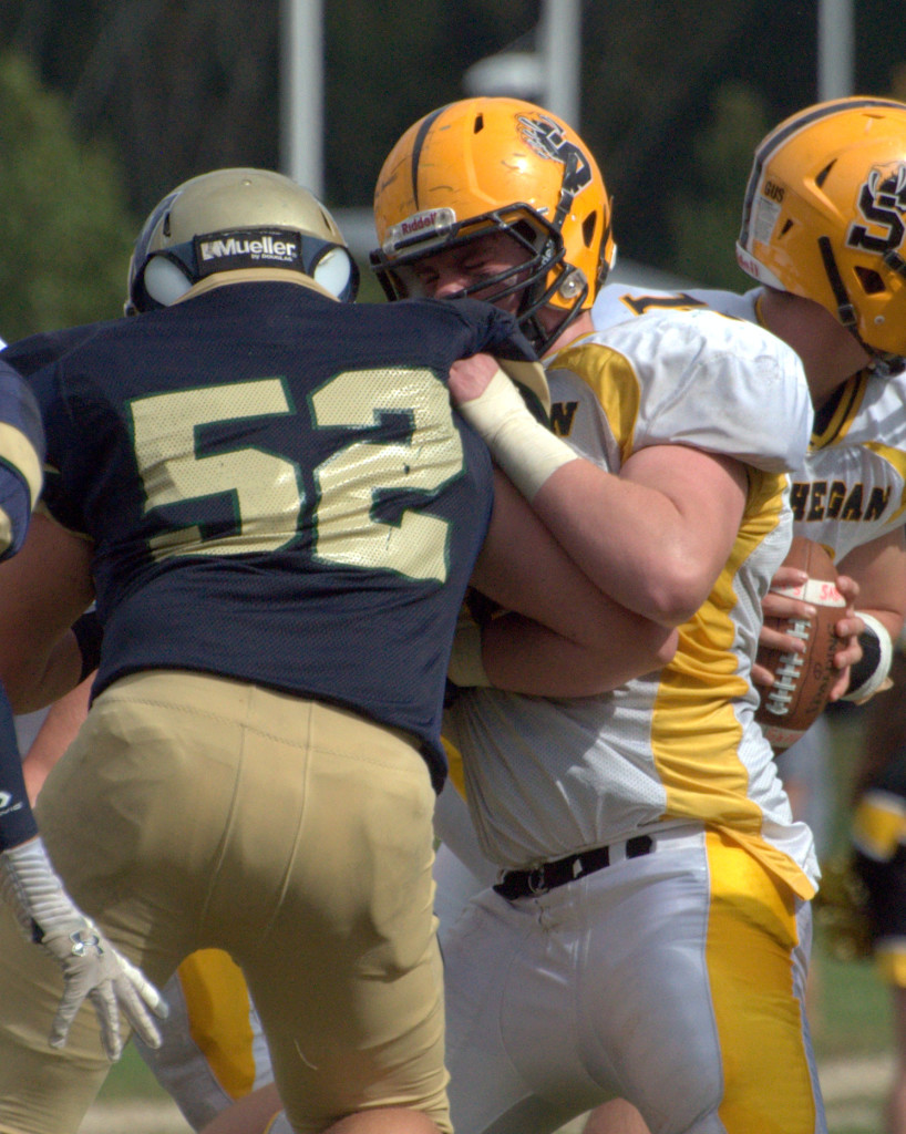 Souhegan's George LePage throws a block during a game last year.