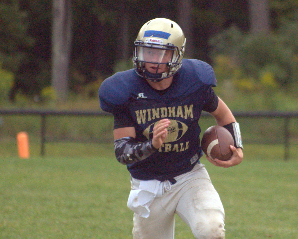 Brendan McInnis runs with the ball during Windham's joint practice with Merrimack on Thursday.