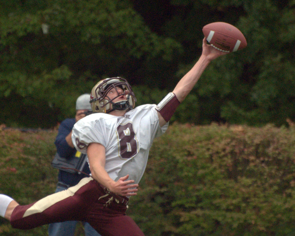 Alvirne's George Notini tries to haul in a pass during Saturday's game.
