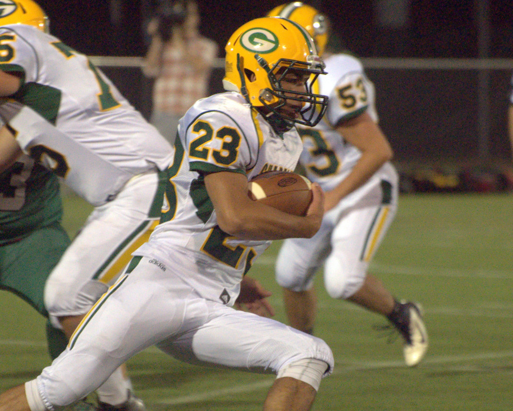 Bishop Guertin's Kelvin Rivera carries the ball during Friday's scrimmage against Manchester Central.