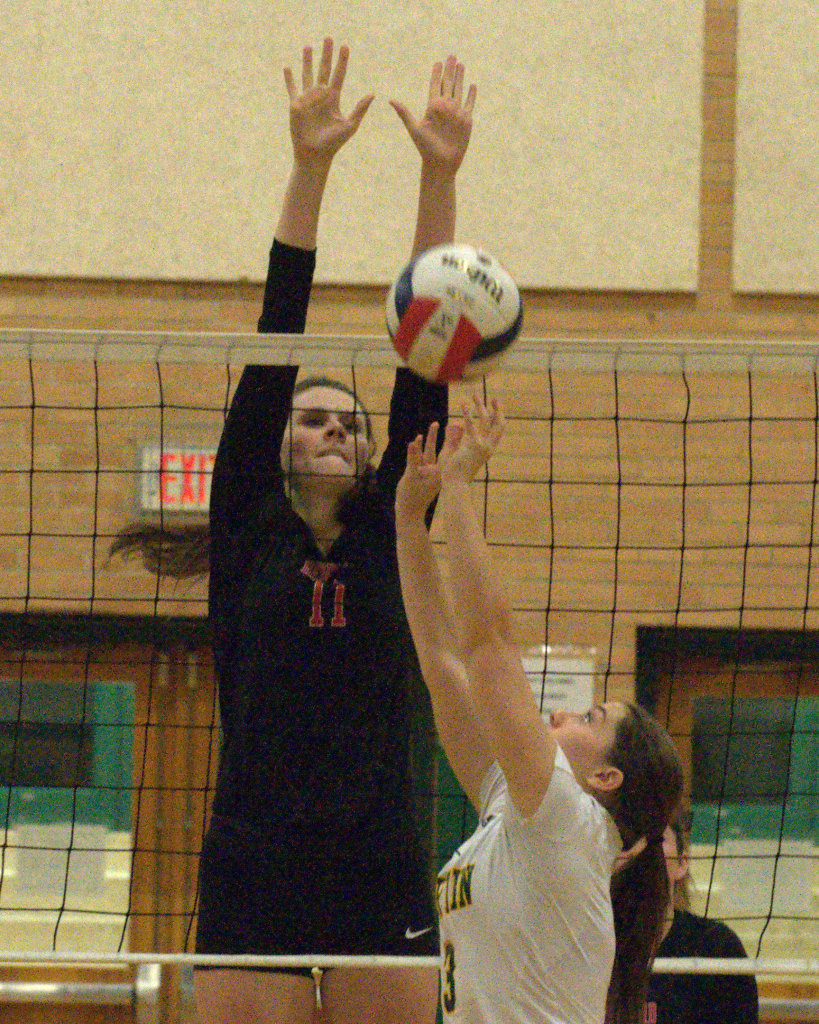 Bedford's Rachel Larrivee tries to block a shot by Bishop Guertin's Jenna McCormack during Tuesday's match.