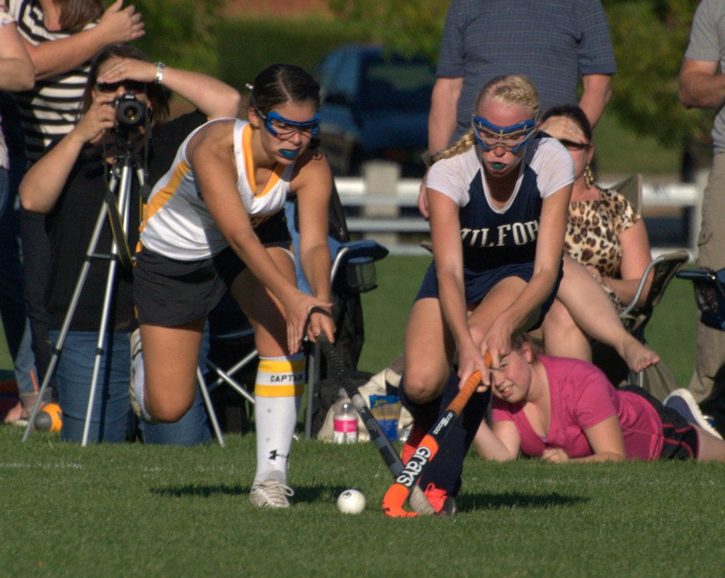 Souhegan's Katie Almeida and Milford's Kelsey Poulter fight for the ball during Friday's game.