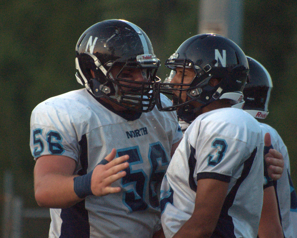 Nashua North's Matt LaVallee, left, celebrates with Miles Cassin-Reed after a touchdown Friday against Timberlane.