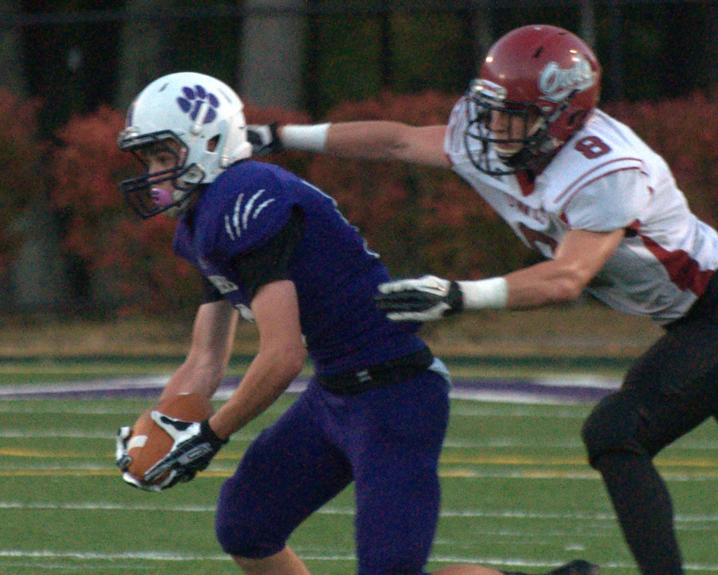 Nashua South's Robbie Smyth tries to escape a tackle during a game last season.