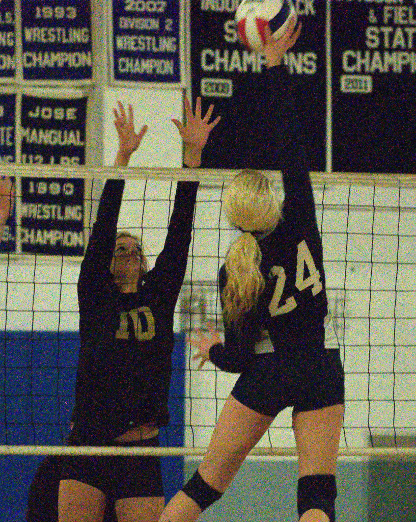 Windham's Basie Bostic tries to block a hit by Milford's Olivia Rougeau during Wednesday's match.