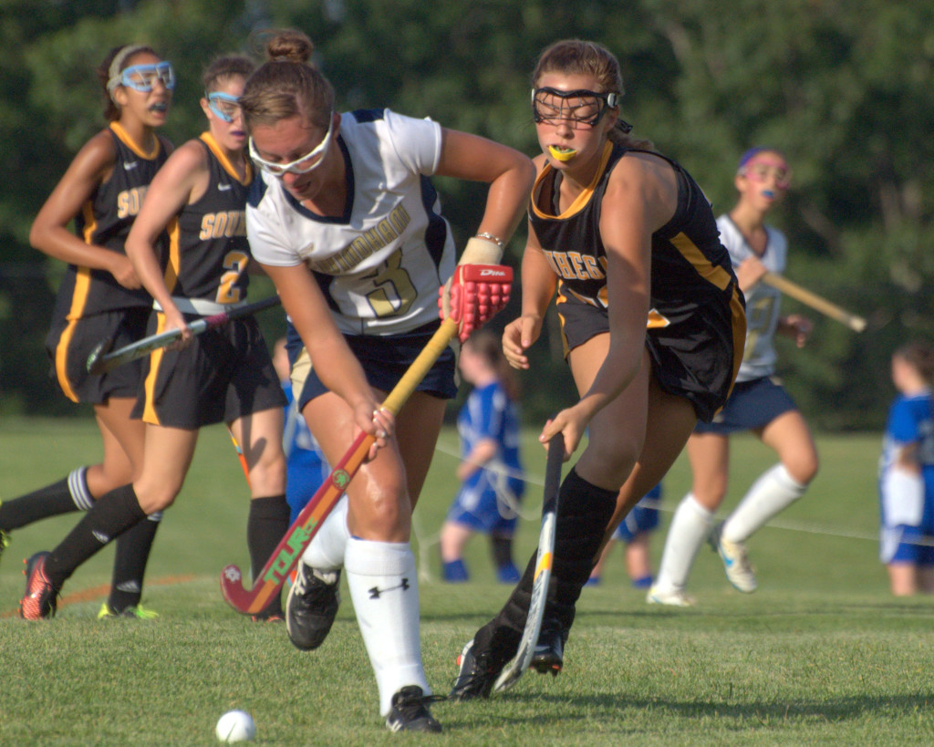 Souhegan's Timber Devine tries to slow down Windham's Rachel Lanouette during Tuesday's game. For more photos, go to the Photo Album.